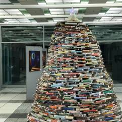 Credit: S.M. O'Connor Caption: All of the books of which the Christmas tree is comprised have either been donated for Friends of the Library sales or have been weeded out of the Woodridge Public Library's holdings.