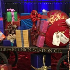 Credit: S.M. O'Connor Caption: This Union Station Company rail car loaded with super-size gifts is part of THE POLAR EXPRESS mock-up in the Great Hall of Chicago's Union Station.
