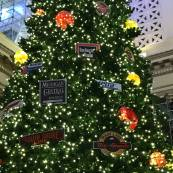 Credit: S.M. O'Connor Caption: This Christmas tree in the Great Hall of Union Station in downtown Chicago has emblems of Amtrak, Metra, and historic railroad companies whose routes they now operate like Burlington.