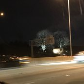 Credit: S.M. O'Connor Caption: While stuck in a traffic jam on I-88, I noticed the lights on the trees flanking the Morton Arboretum sign were changing colors.  I took these pictures over the driver's shoulder.